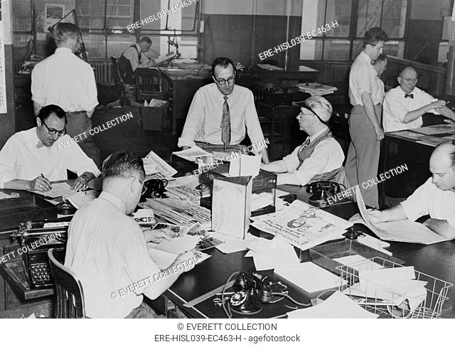 The City Desk, the department that handled local news. In the offices of the New York World-Telegram and the Sun Newspaper. May 12, 1949
