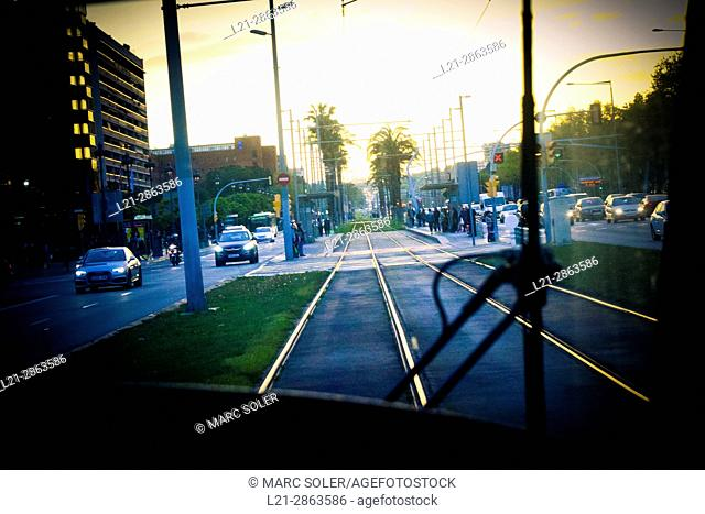Interior of a tram. Rails and cityscape at dusk. Barcelona, Catalonia, Spain