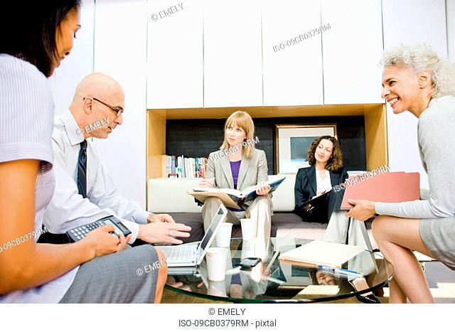 5 business people talking