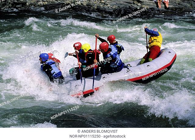 People white water rafting on Sjoa river in Norway