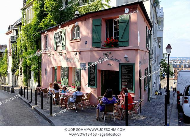 Europe, France, Paris, Montmartre, La Maison, Rose French Cafe - Rue de l'Abreuvoir, People walking on street and car parked on streetside - August 2015