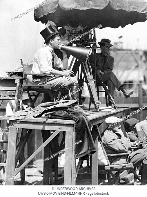 "Hollywood, California:  1921  Director Rex Ingram with megaphone, cigar, top hat and knee high boots at work on the set of """"The Four Horsemen of the..."
