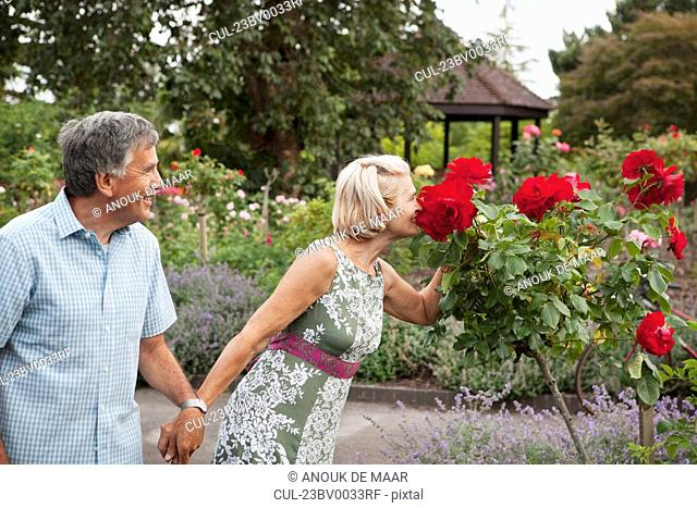 Mature couple in rose garden