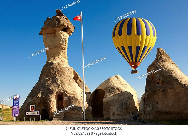 """Pictures & images of hot air balloons over the fairy a chimney rock Police Station at """"Pasaba Valley"""" near Goreme, Cappadocia, Nevsehir, Turkey"""