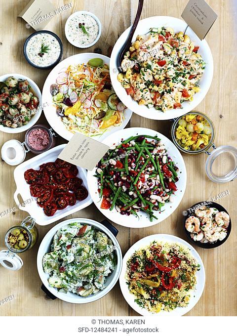 Various salads, pickled vegetables, shrimps and spreads