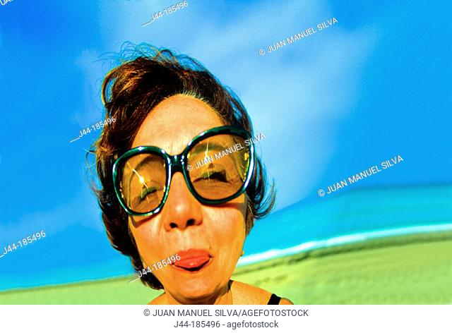 Distorted woman's face with sun glasses