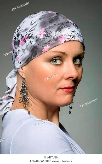 Portrait of beautiful middle age woman patient with cancer wearing headscarf, hope in healing. She lost her hair