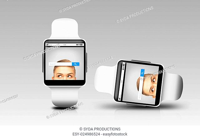 modern technology, object, responsive design and media concept - smart watches with internet browser search bar on screen over gray background