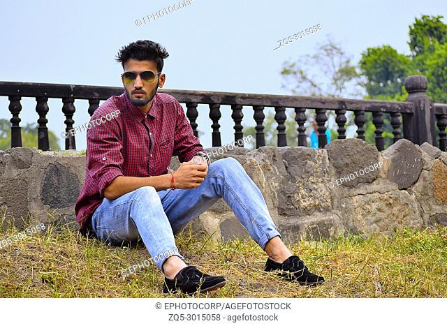 Young man with checked shirt and sun glasses, Pune, Maharashtra