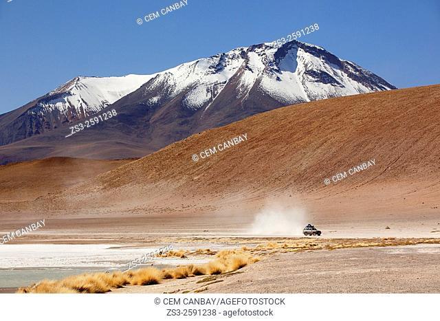 Cross-country vehicle near Laguna Canapa on Salar Uyuni salt desert, Bolivia, South America