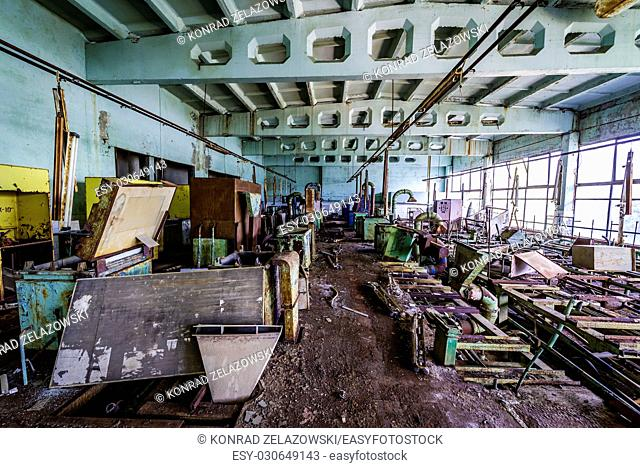 Inside the lacquering hall of abandoned Jupiter Factory in Pripyat ghost town of Chernobyl Nuclear Power Plant Zone of Alienation in Ukraine