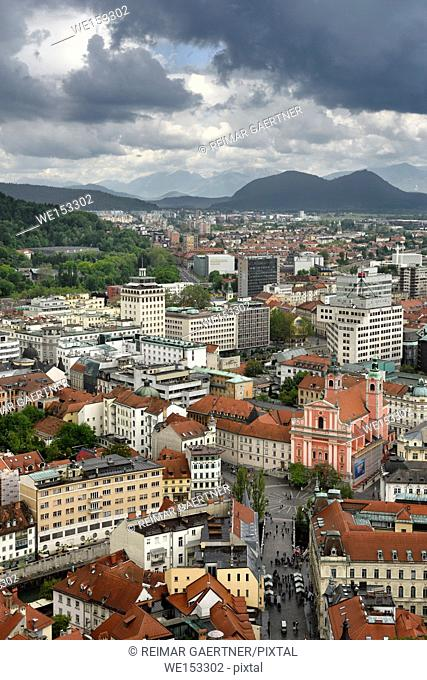 Ljubljana Slovenia with Karawanks, Kamnik Savinja, limestone Alps and Franciscan Church of the Annunciation Preseren Square from Castle Hill