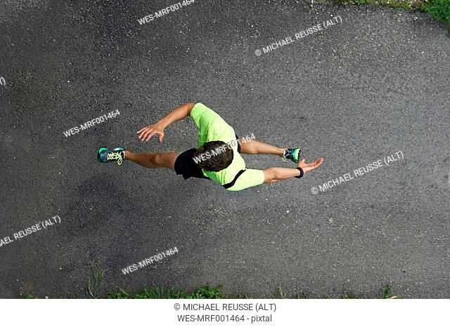 Elevated view of running man
