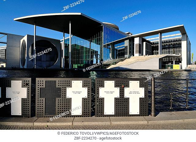 Germany, Berlin. Crosses commemorating the dead of the Berlin Wall, on the banks of the Spree river in front of the Paul Lobe building