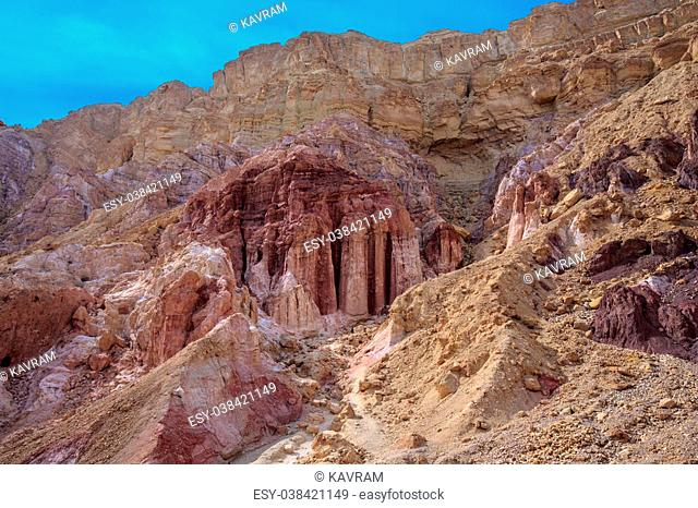 "Gorge in the dry mountains of Eilat and natural """"Amram pillars"""" of pink sandstone. Warm January day in Israel"