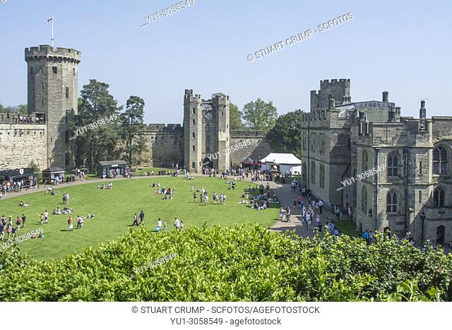 Visitors in the courtyard of Warwick Castle, Warwickshire, England