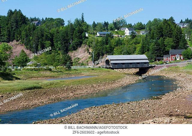 Canada St Martins New Brunswick small fishing village with covered bridge in harbor and curved river