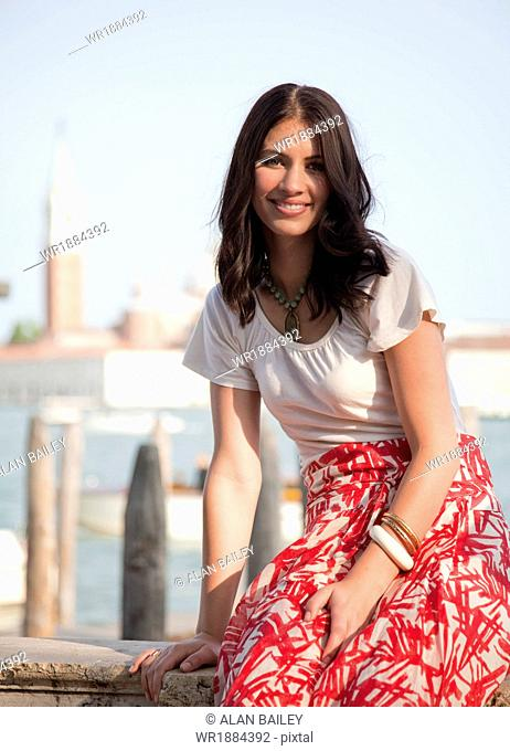 Italy, Venice, Portrait of young woman by lagoon