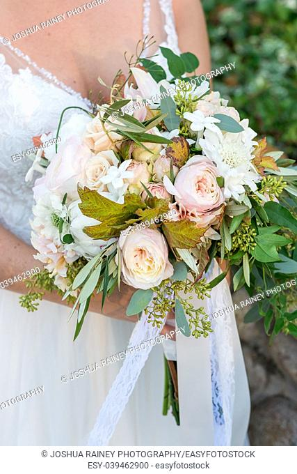 Bride holding her bouquet at a winery wedding in California during the fall