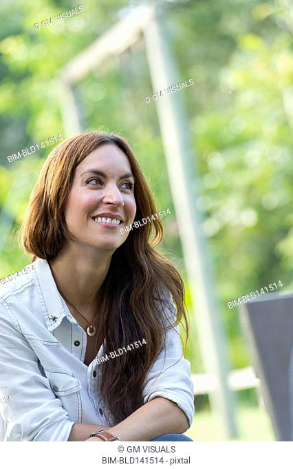 Hispanic woman smiling outdoors