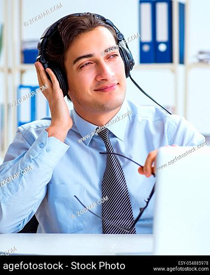 The sales assistant listening to music during lunch break