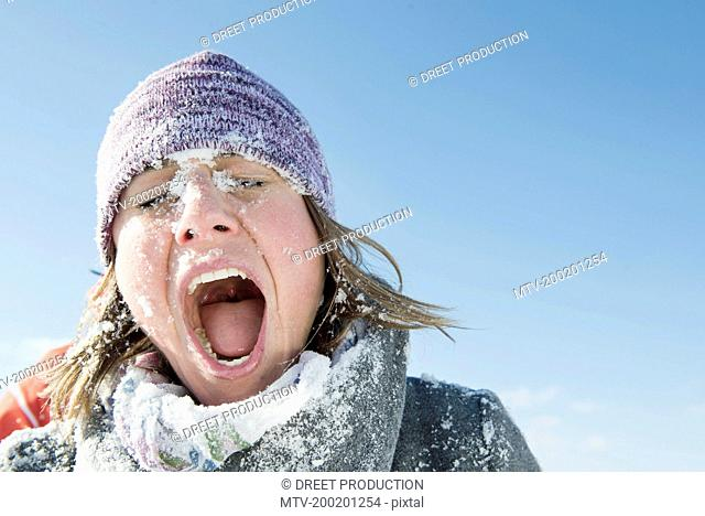 Woman hit by snowball, Bavaria, Germany
