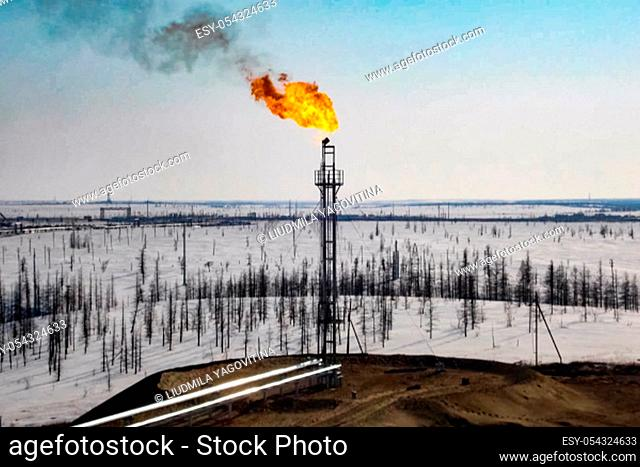 Burning a torch with natural gas in an oil industrial facility Oil refinery. Construction of an oil industrial facility