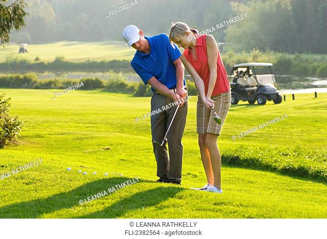 Duncan Savage, golf pro, teaches a lesson at the Whistler Golf Course; Whistler, British Columbia, Canada