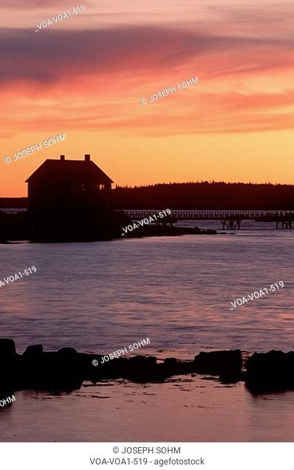 Silhouette of house at sunrise, Mt. Desert Island, Maine