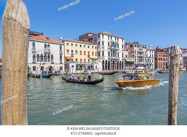 Venice, Venice Province, Veneto Region, Italy. Traffic on the Grand Canal. The gondola is a traghetto, which ferries passengers from one side of the canal to...