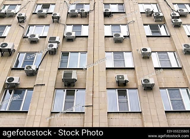 mani air conditioners on the wall of office building