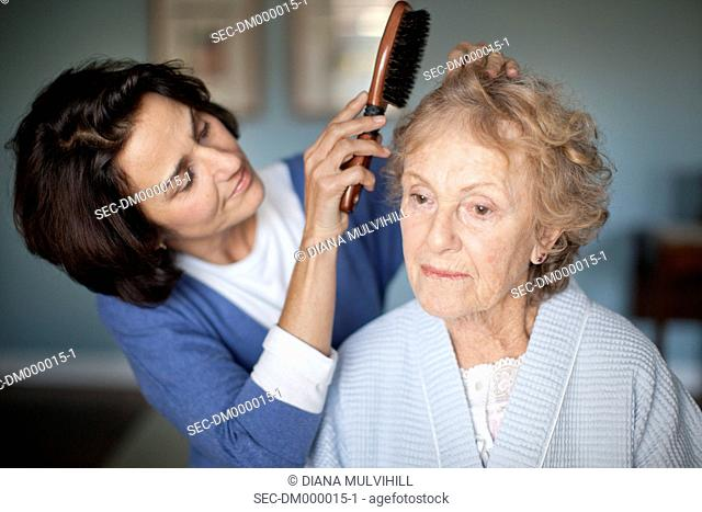 Mature woman with senior mother