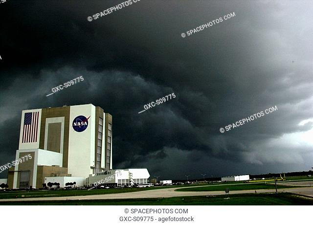 06/18/2002 -- Black storm clouds hang over the Vehicle Assembly Building and Launch Control Center, bringing thunder and heavy rain to the area