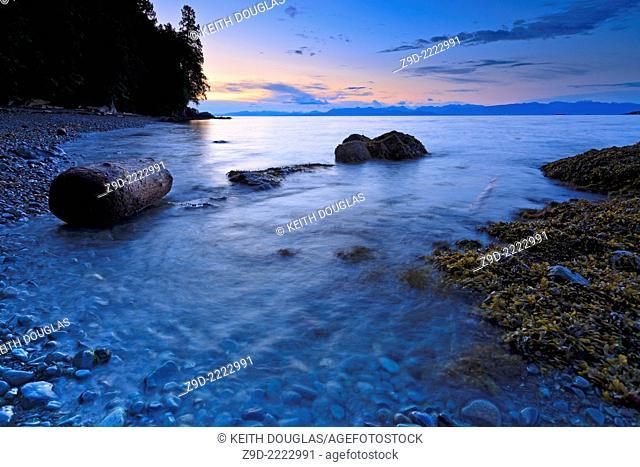 Long exposure of shoreline scene overlooking Georgia Strait, near Nanaimo, Vancouver Island, British Columbia