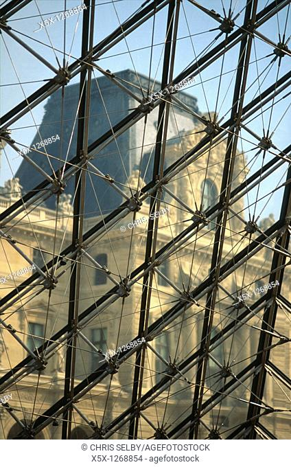 The Louvre museum seen from inside the glass pyramid in Paris, France