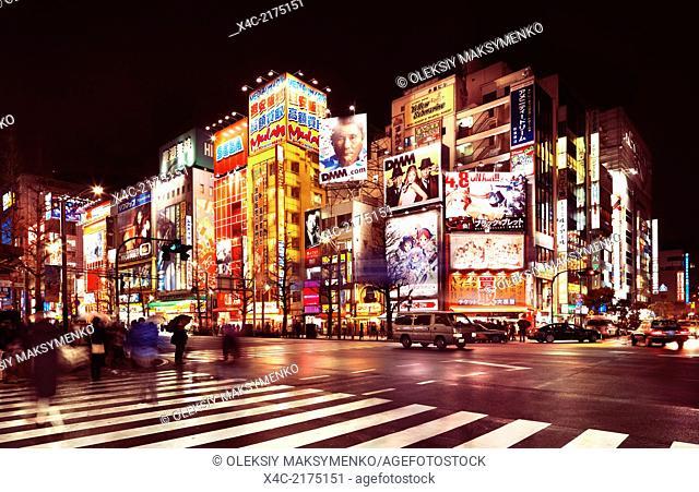 Akihabara streets with shining colorful signs at nighttime in Tokyo, Japan
