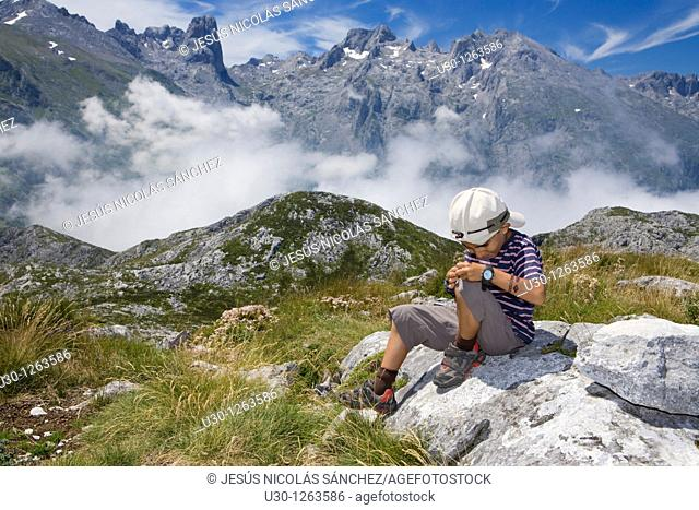 Boy in the summit of Peña Maín, Urrieles massif, in the Picos de Europa National Park, Asturias, Spain