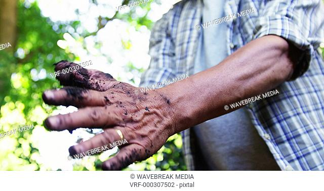 Senior man cleaning his hands