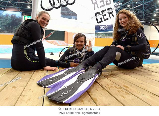 Watersport enthusiasts pose for the photographers in Duesseldorf,Germany, 17January 2014. Around 1,650 exhibitors from 60 countries are taking part in the...