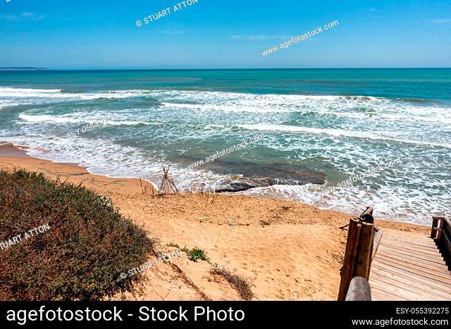coastal sea, surf and sand on Guardamar beach area near Alicante