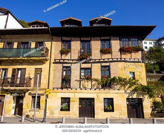 Typical house and balcony with flowers. Pasai Donibane. Fishing village of Pasajes de San Juan. San Sebastian, Bay of Biscay, province of Gipuzkoa