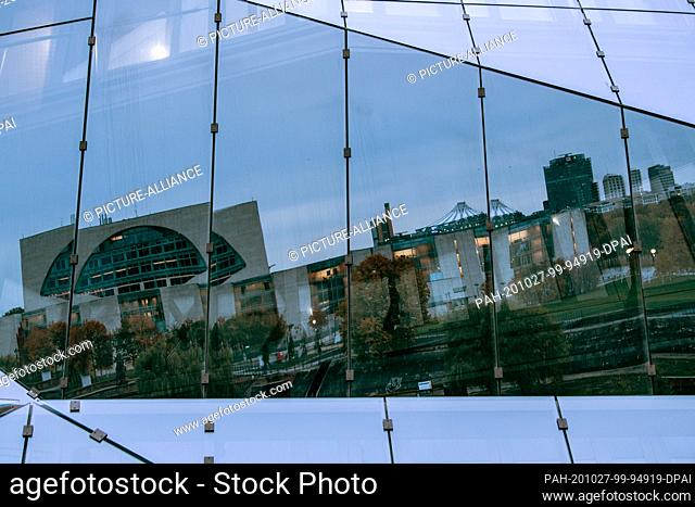 27 October 2020, Berlin: The Federal Chancellery and the buildings at Potsdamer Platz are reflected in a glass façade. Photo: Paul Zinken/dpa-Zentralbild/dpa