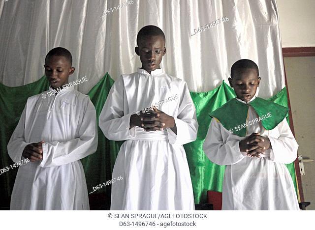 Altar boys praying, Sunday mass at the Roman Catholic Parish of Buza, Dar es Salaam, Tanzania