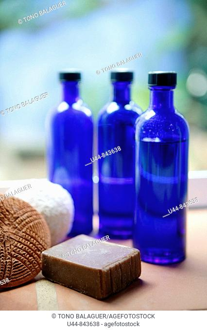 three blue glass bottles and soap in the bathroom