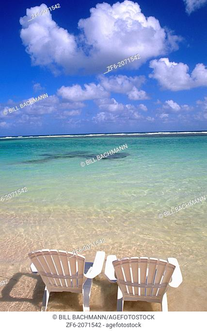 Chairs on beautiful beach in Cozumel Mexico