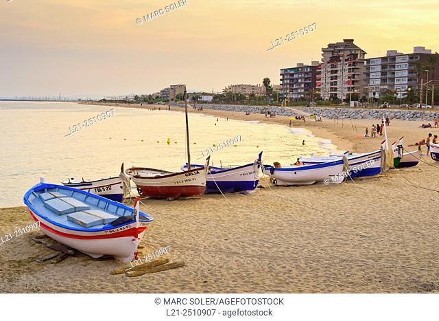 Fishing boats on the beach at sunset. Vilassar de Mar, Maresme, Barcelona province, Catalonia, Spain