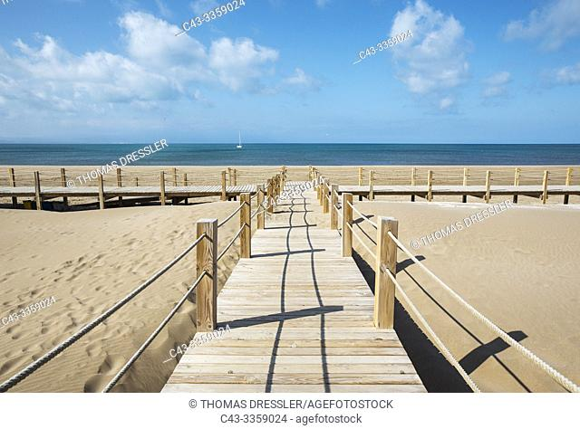 Wooden footbridges at the beach of Riumar. Environs of the Ebro Delta Nature Reserve, Tarragona province, Catalonia, Spain
