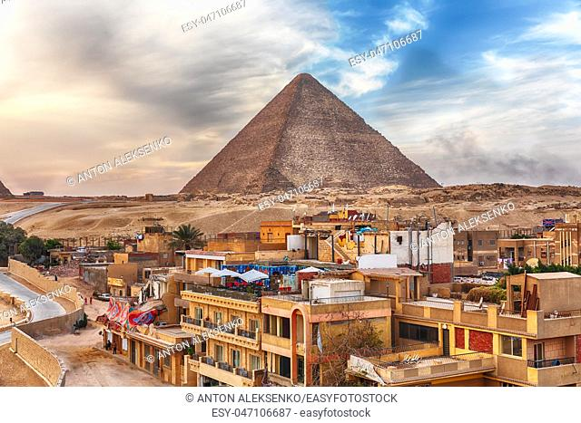 The Pyramid of Cheops and Giza town nearby, Cairo, Egypt