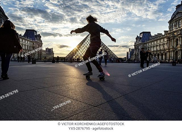 Roller skating practice at Louvre Pyramid at sunset