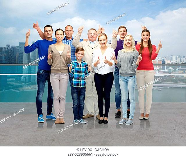 gesture, family, generation and people concept - group of smiling men, women and boy showing thumbs up over singapore city waterside background